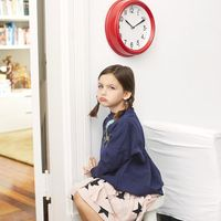 Little Girl Upset Sitting on Time Out in Corner