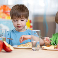 Two Boys Eating at Day Care