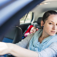 mom driving with baby in backseat
