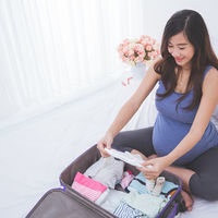 Pregnancy Travel Woman Packing Suitcase