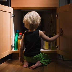 Cupboard full of child poisoning hazards