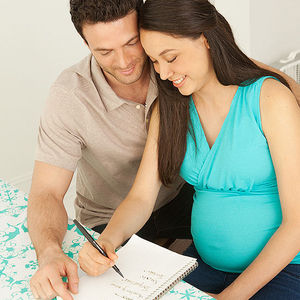 couple looking at baby name list