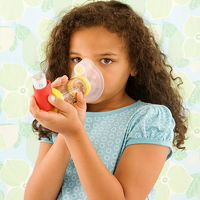 child with asthma using inhaler