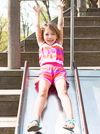 Child going down slide