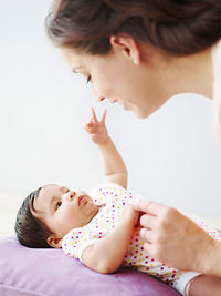 Mother talking to baby