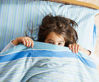 child in bed