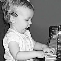 "At 16 months, she played the piano and ""sang."""