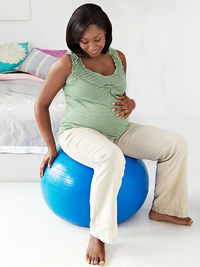 pregnant woman on exercise ball