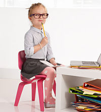 Girl at desk with glasses and pencil