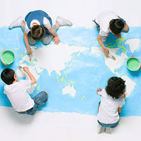 Kids painting map of world on floor