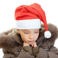 sad child wearing Santa hat
