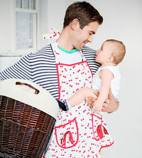 dad in apron with baby