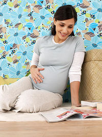 Pregnant woman reading a magazine