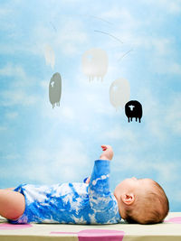 Baby reaching up to mobile