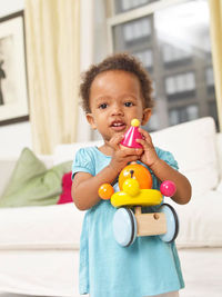 little girl holding a toy