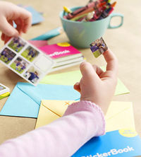 girl placing sticker on card