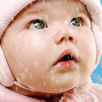 Baby watching snow fall