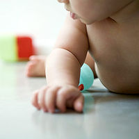 baby on floor with toys
