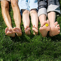 family lying down in the grass