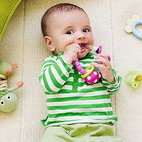 baby chewing on teething toy