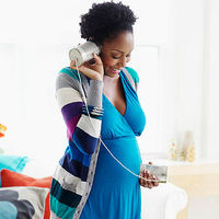 Woman listening to her tummy