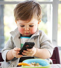 baby playing with phone - Little Kids Pictures