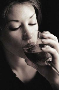Woman Drinking Glass of Wine in Black and White