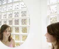 girl looking into mirror