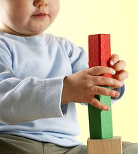 baby playing with blocks