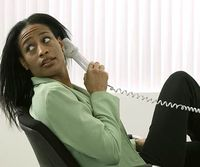 woman covering phone mouthpiece