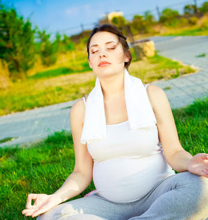 pregnant woman practicing breathing