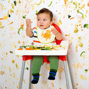 Messy Kid in Highchair