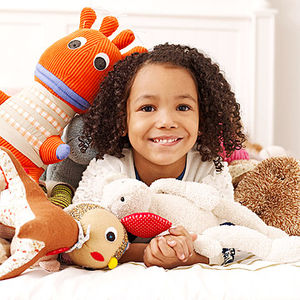 child playing with toy stuffed animals