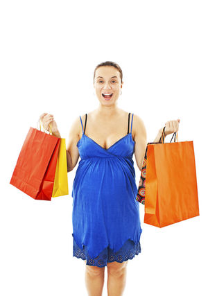 mom holding shopping bags