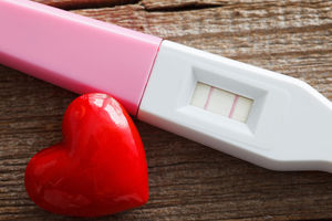 pink pregnancy test and heart
