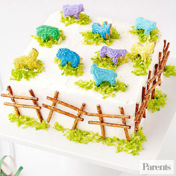 Animal cracker topped cake with fence