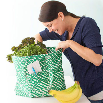 Woman looking through grocery sack