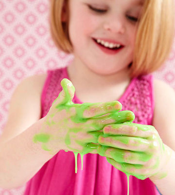 child playing with green slime