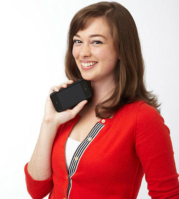 woman holding cell phone