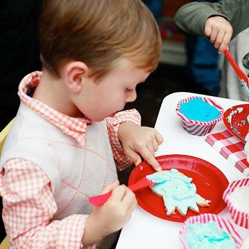 Child painting cookies