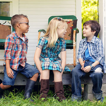 Kids in plaid talking on porch