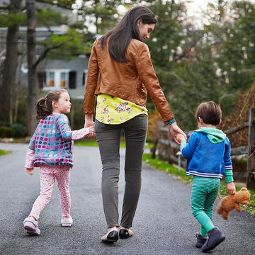 Mom holding hands with kids
