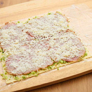 layer puff pastry with broccoli spread, ham and cheese
