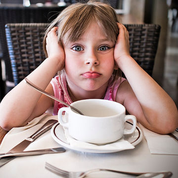 child bored at restaurant