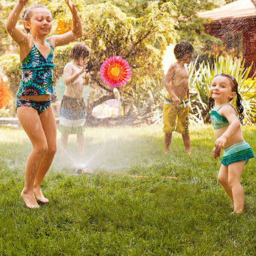 Kids dancing in sprinklers