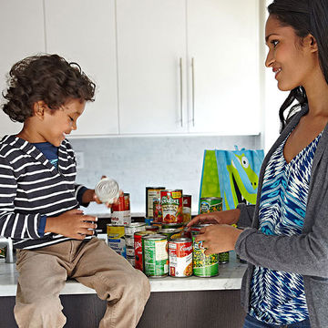 Mom and son collecting cans