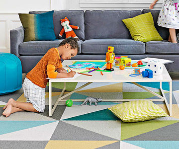 boy coloring on coffee table