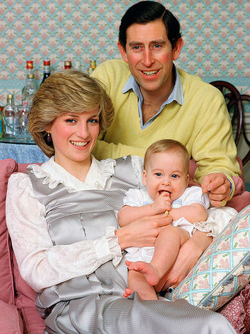 Prince And Princess Of Wales holding Prince William