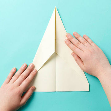 Folding paper airplane