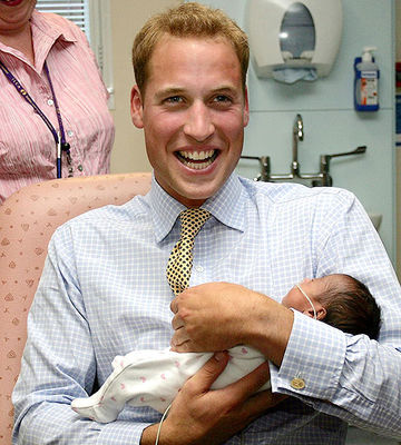 Prince William Carries a Baby